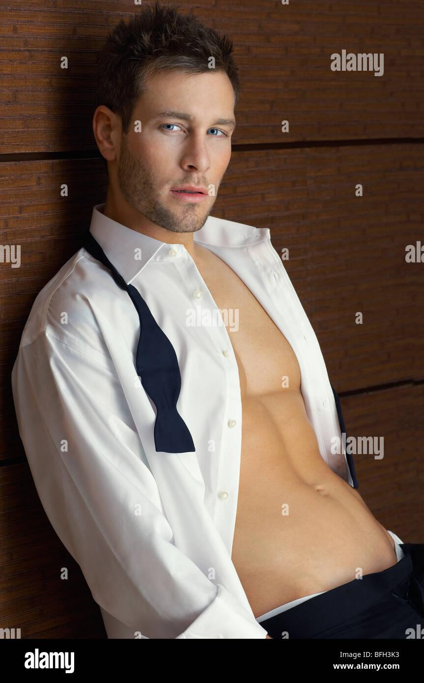 Man wearing tuxedo, indoors, portrait - Stock Image