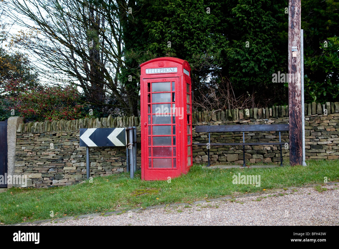 Red Public Telephone kiosk as seen in the U.K., Malta, Bermuda and Gibraltar and made of cast iron - Stock Image