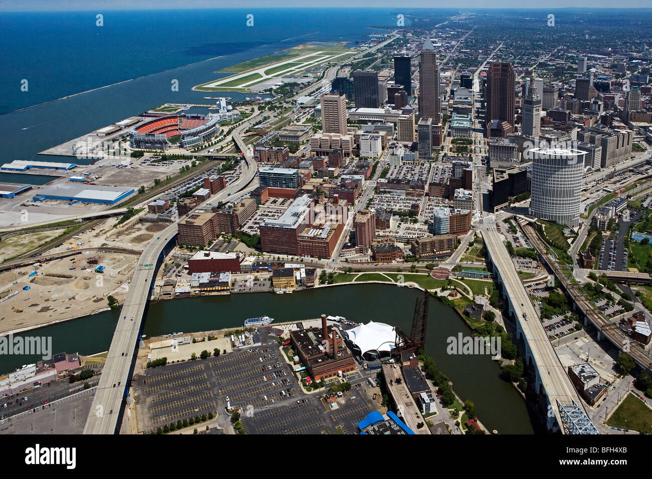 aerial view above downtown Cleveland Ohio Cuyahoga river Lake Erie stadium Burke Lakefront airport Stock Photo