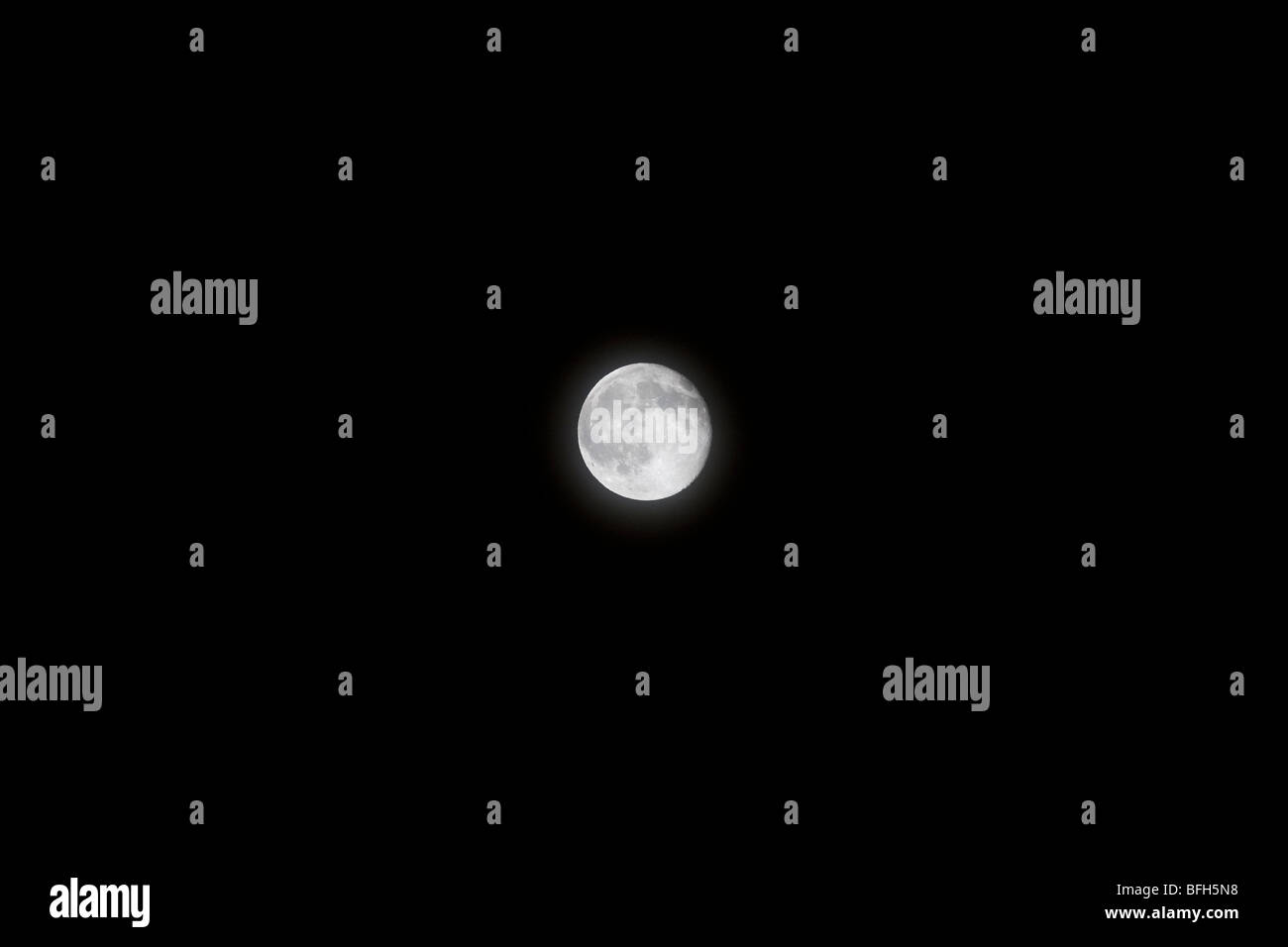 Detailed full moon in a pure black sky - Stock Image
