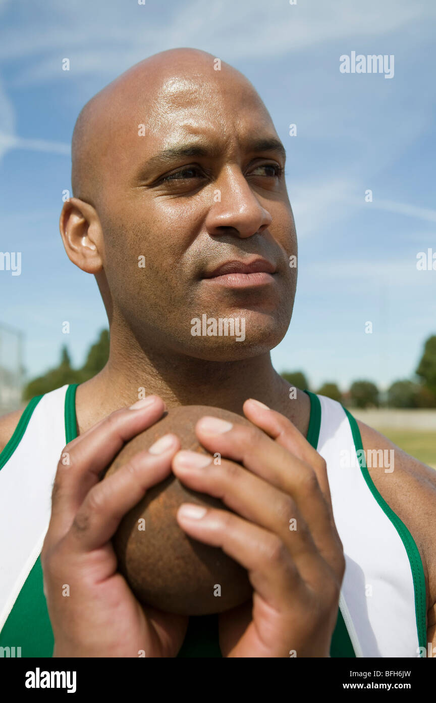 Male shot putter gripping shot - Stock Image