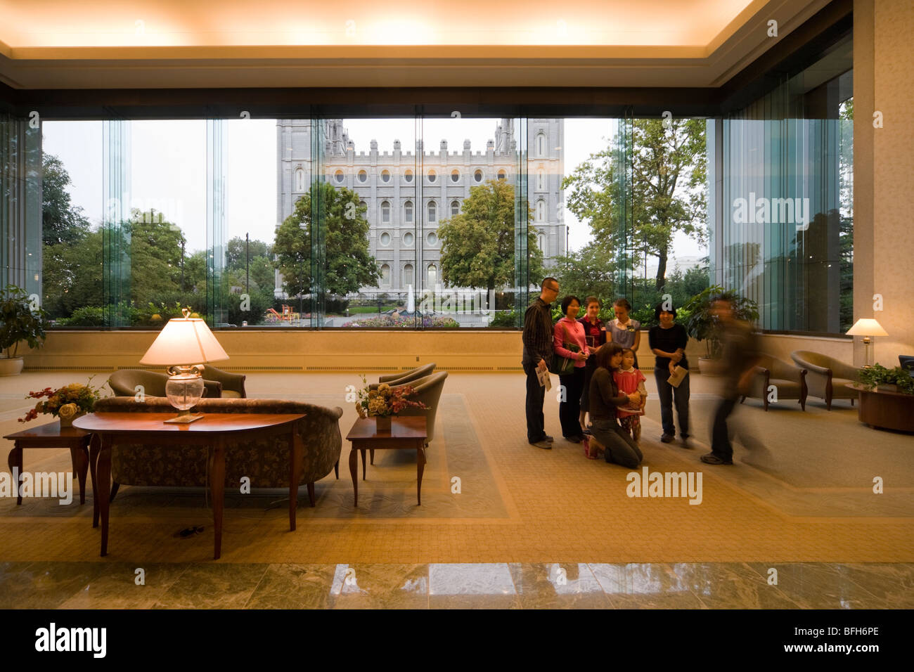 South Visitors' Center, Temple Square, Salt Lake City. A visiting family posing for the camera in front of the - Stock Image