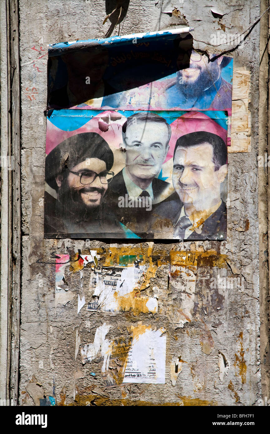 Poster with Hafez al-Assad, Bashar al-Assad and Nasrallah (leader of Hezbollah party) on a wall, Damascus, Syria, - Stock Image