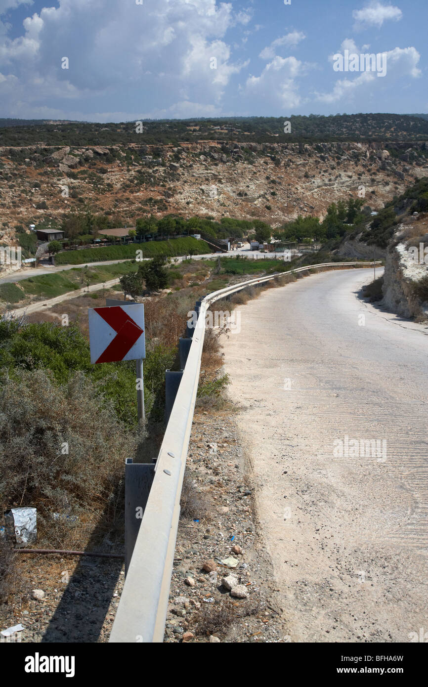 steep mountain road down to the end of the road at white river canyon akamas peninsula republic of cyprus europe - Stock Image