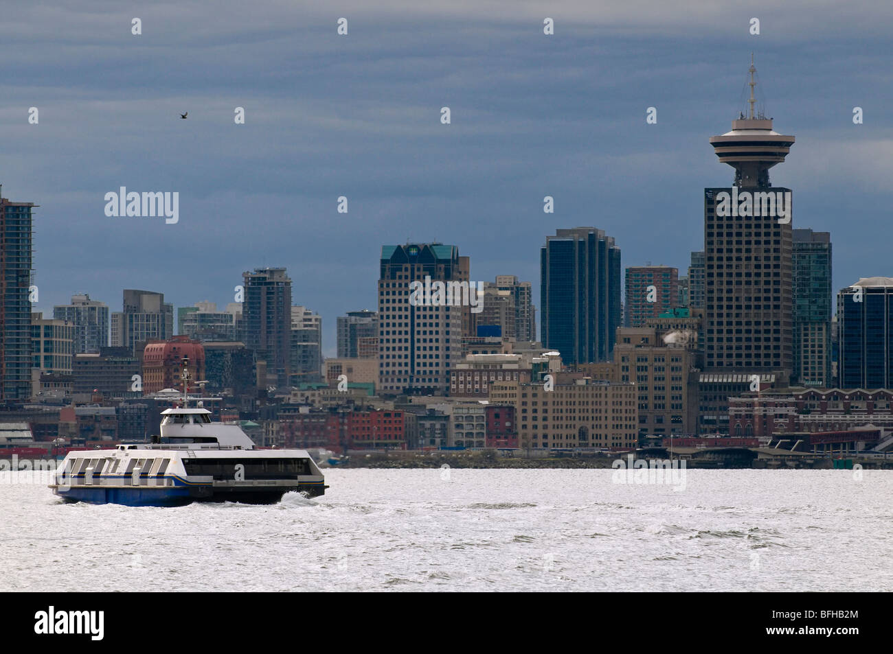 A Seabus crosses the Vancouver harbour towards downtown Vancouver. - Stock Image