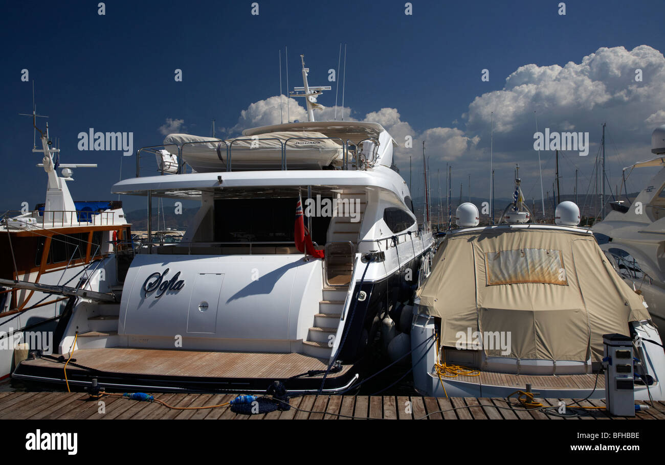 rear of luxury motor cruisers yachts in the harbour in latchi village in the polis municipality republic of cyprus - Stock Image