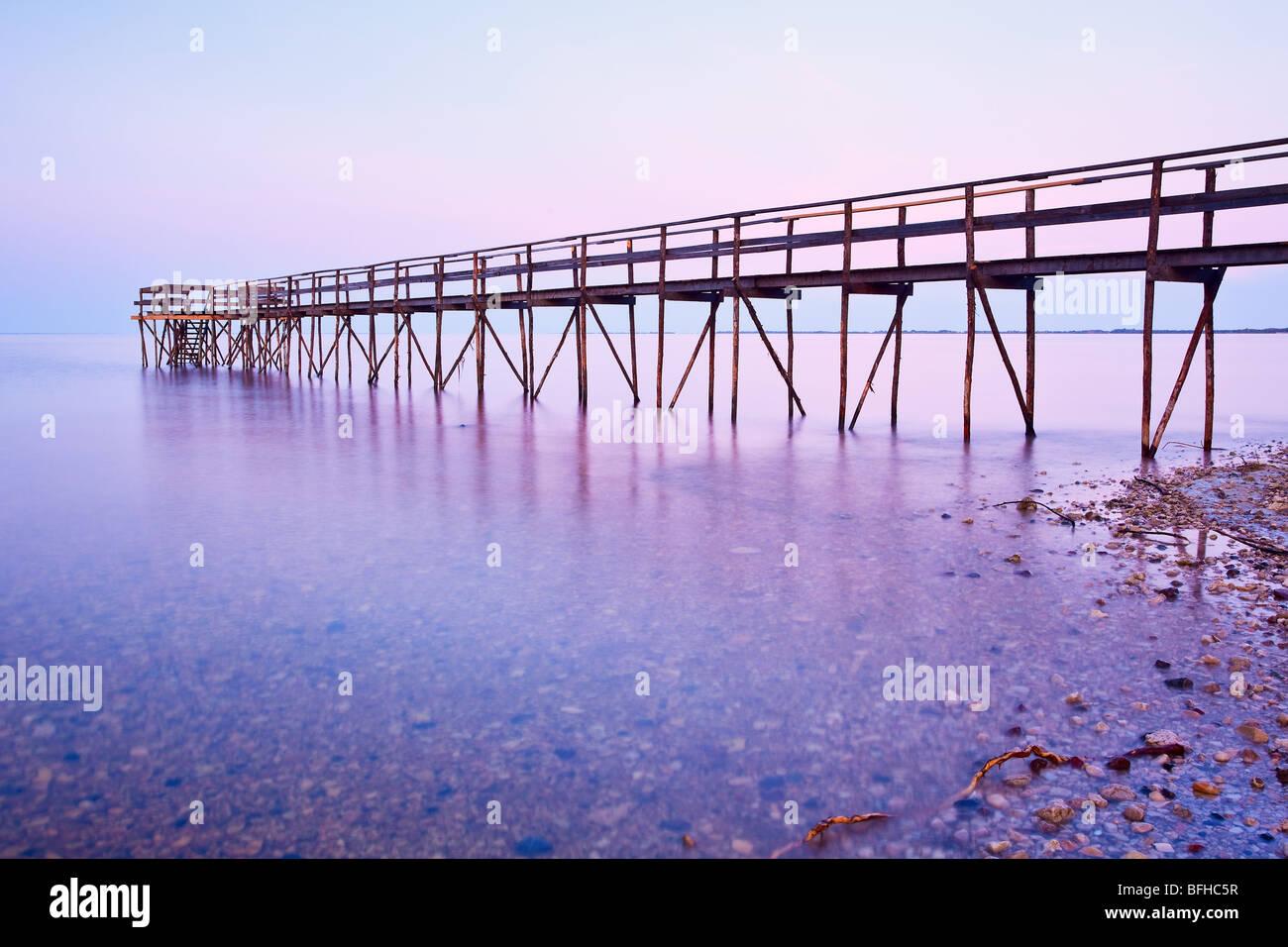 Wooden Pier on Lake Winnipeg at dusk.  Matlock, Manitoba, Canada. - Stock Image
