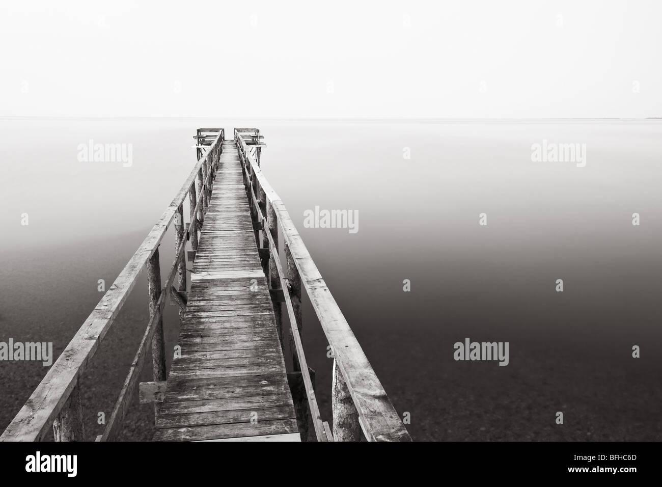 Wooden Pier on Lake Winnipeg.  Rebuilt every spring due to the Lake freezing solid.  Matlock, Manitoba, Canada. - Stock Image
