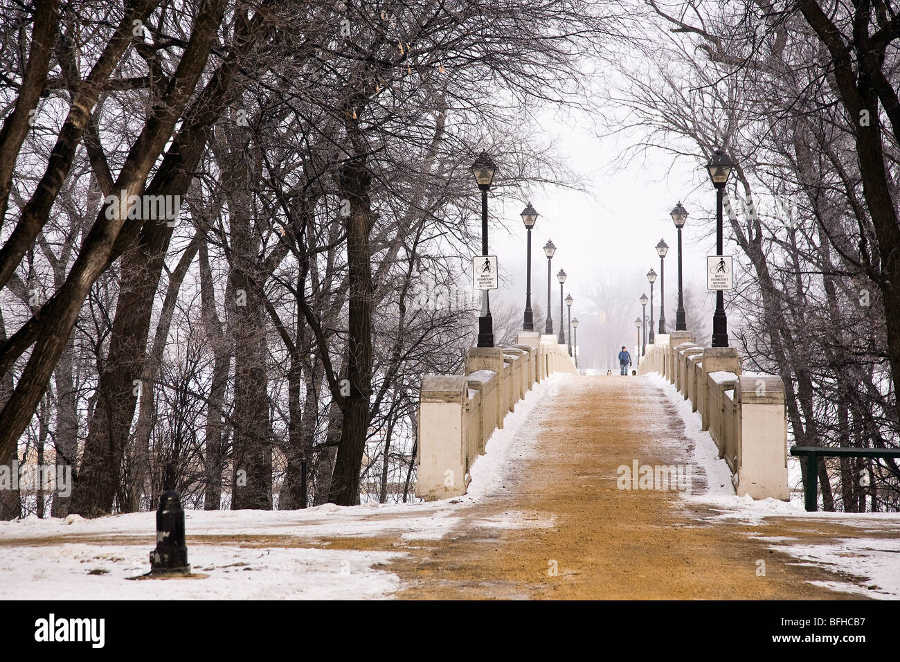 Freshly sanded Assiniboine Park Footbridge on foggy winter morning.  Winnipeg, Manitoba, Canada. - Stock Image