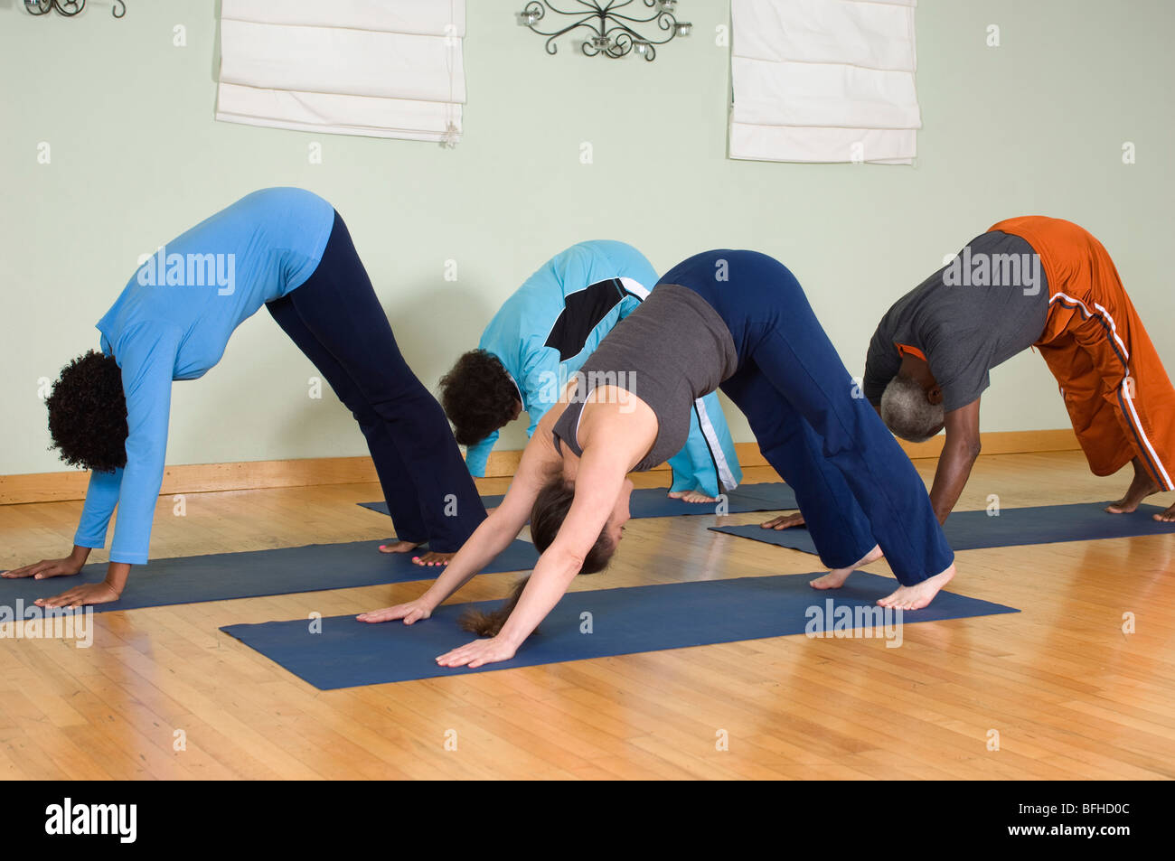 Yoga Class Stretching - Stock Image