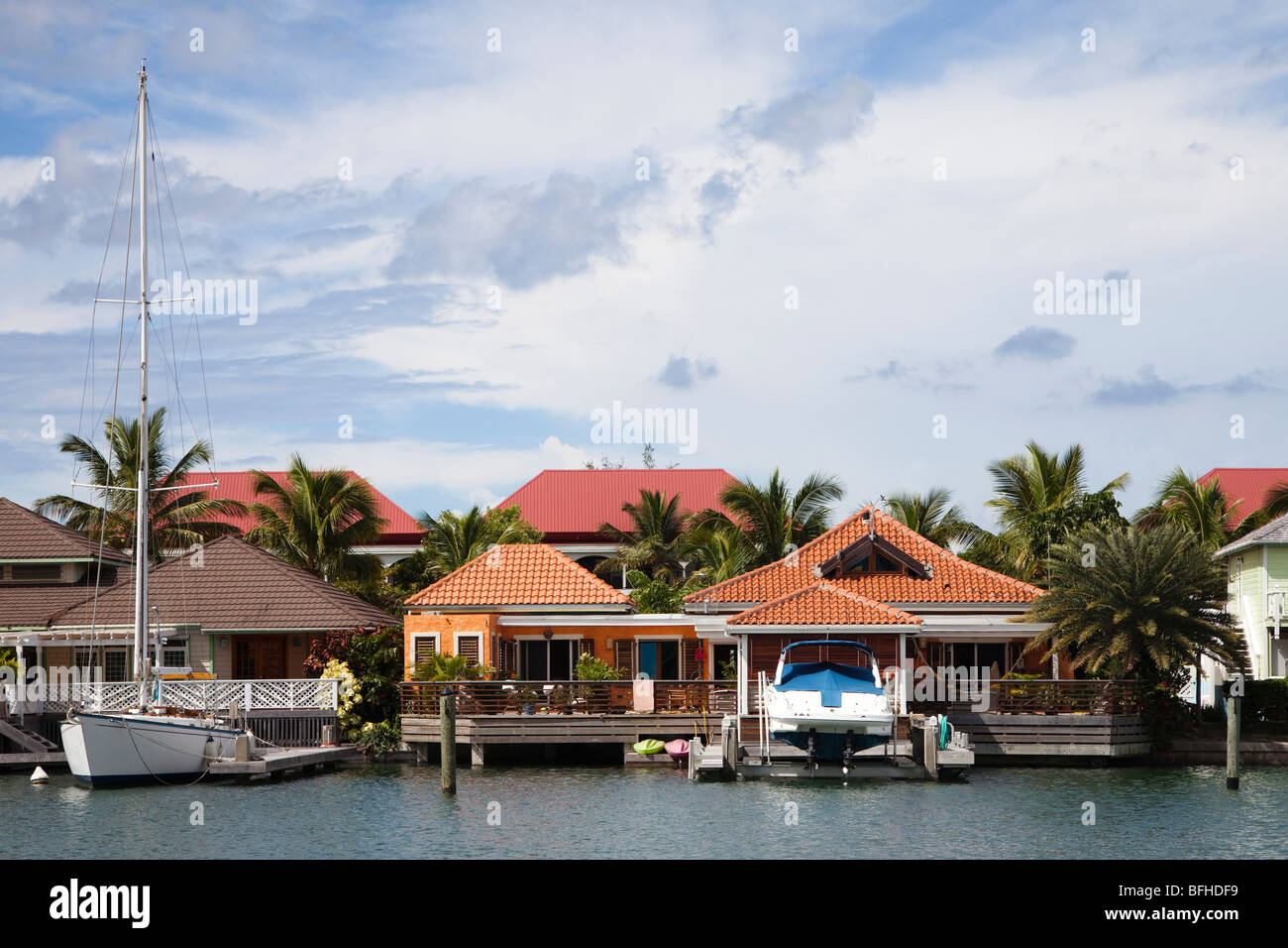 Harbourside houses at the marina in Jolly Harbour, Antigua, Caribbean, West Indies - Stock Image