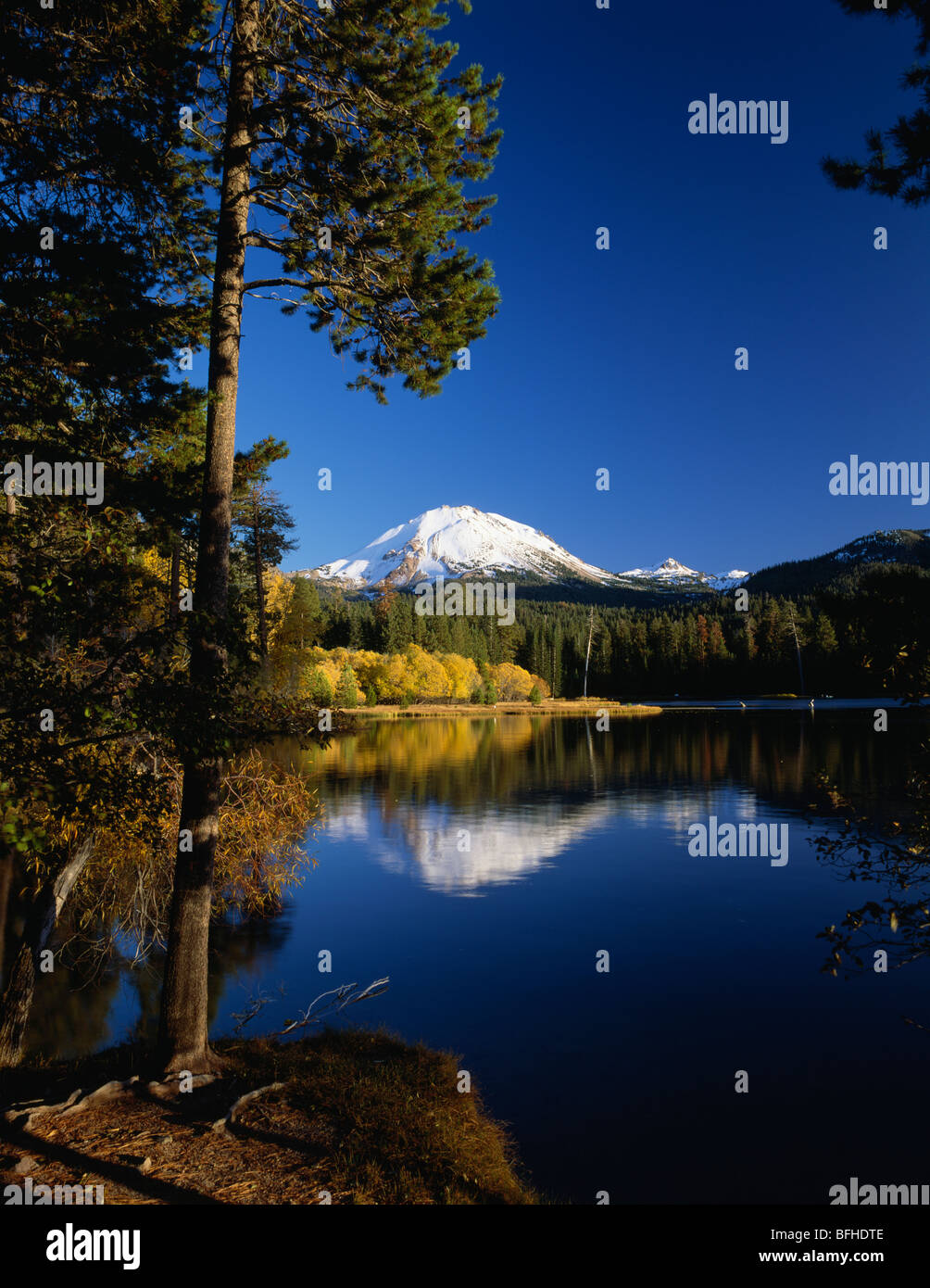 Mount Lassen and Manzanita Lake with fall colors and trees Lassen Volcanic National Park, Northern California USA - Stock Image