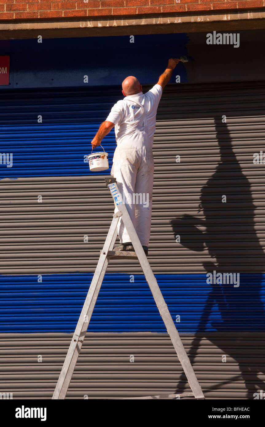 A Painter and decorator at work in Norwich,Norfolk,Uk - Stock Image