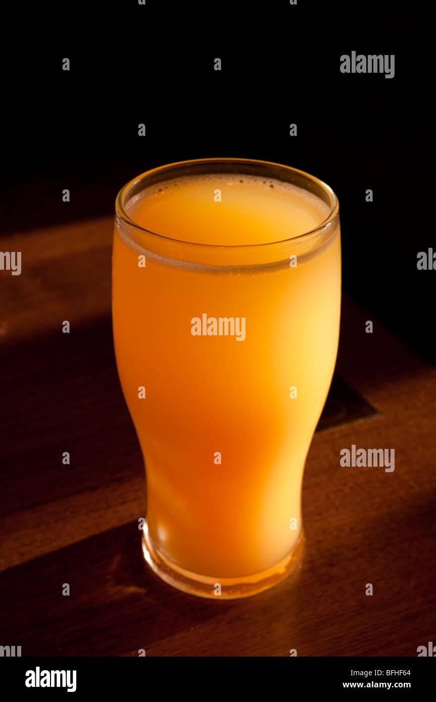 uk england pint of orange juice - Stock Image
