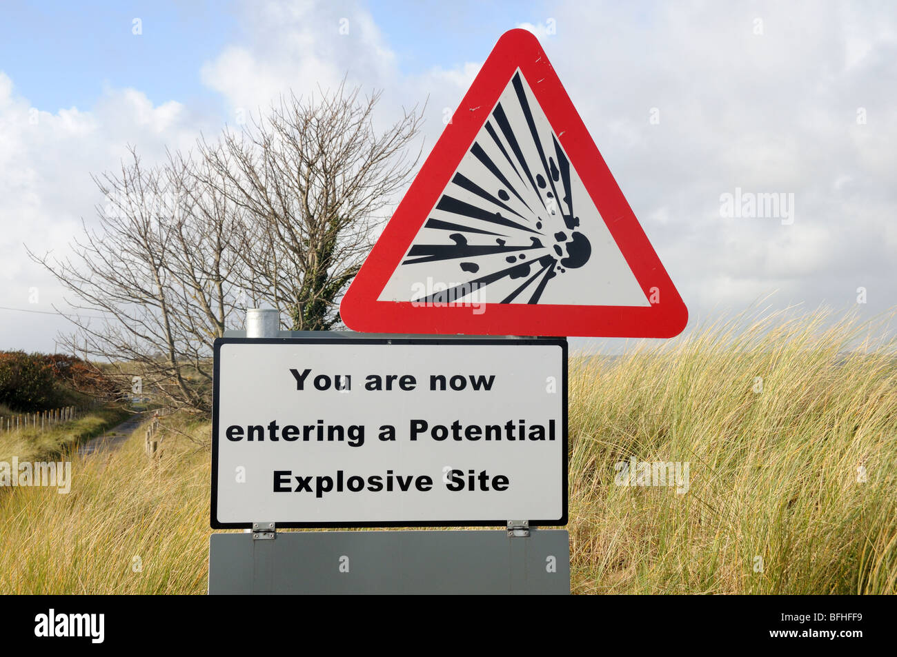 Warning Sign on the road through MOD land towards Ginst Point Pendine Carmarthenshire Wales Cymru UK GB - Stock Image