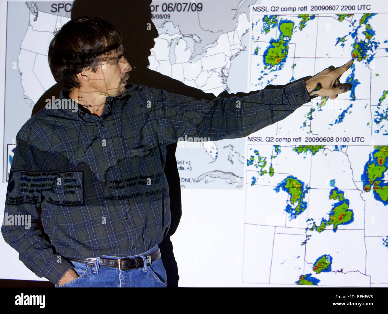 Doctor Eric Rasmussen points at a weather forcast map in Wichita, Kansas, USA, June 9, 2009 Stock Photo