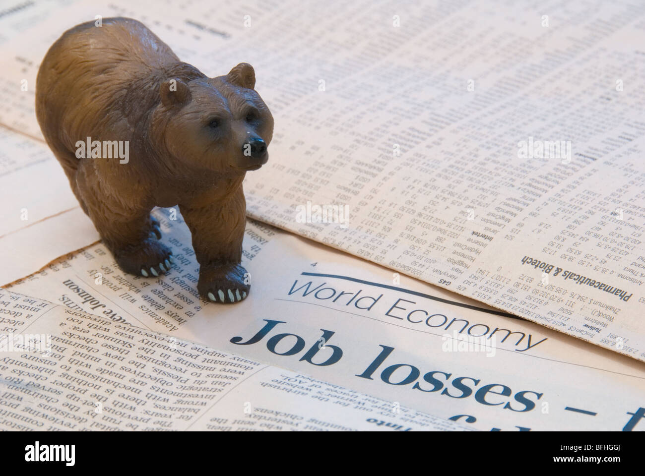 A Bear over the World Economy reports of Job Losses representing the Finance Markets Stock Photo