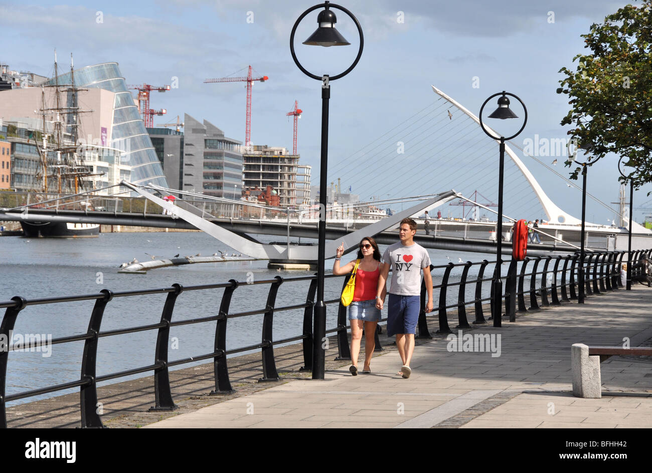 Couple walking by the Liffy Dublin Ireland - Stock Image