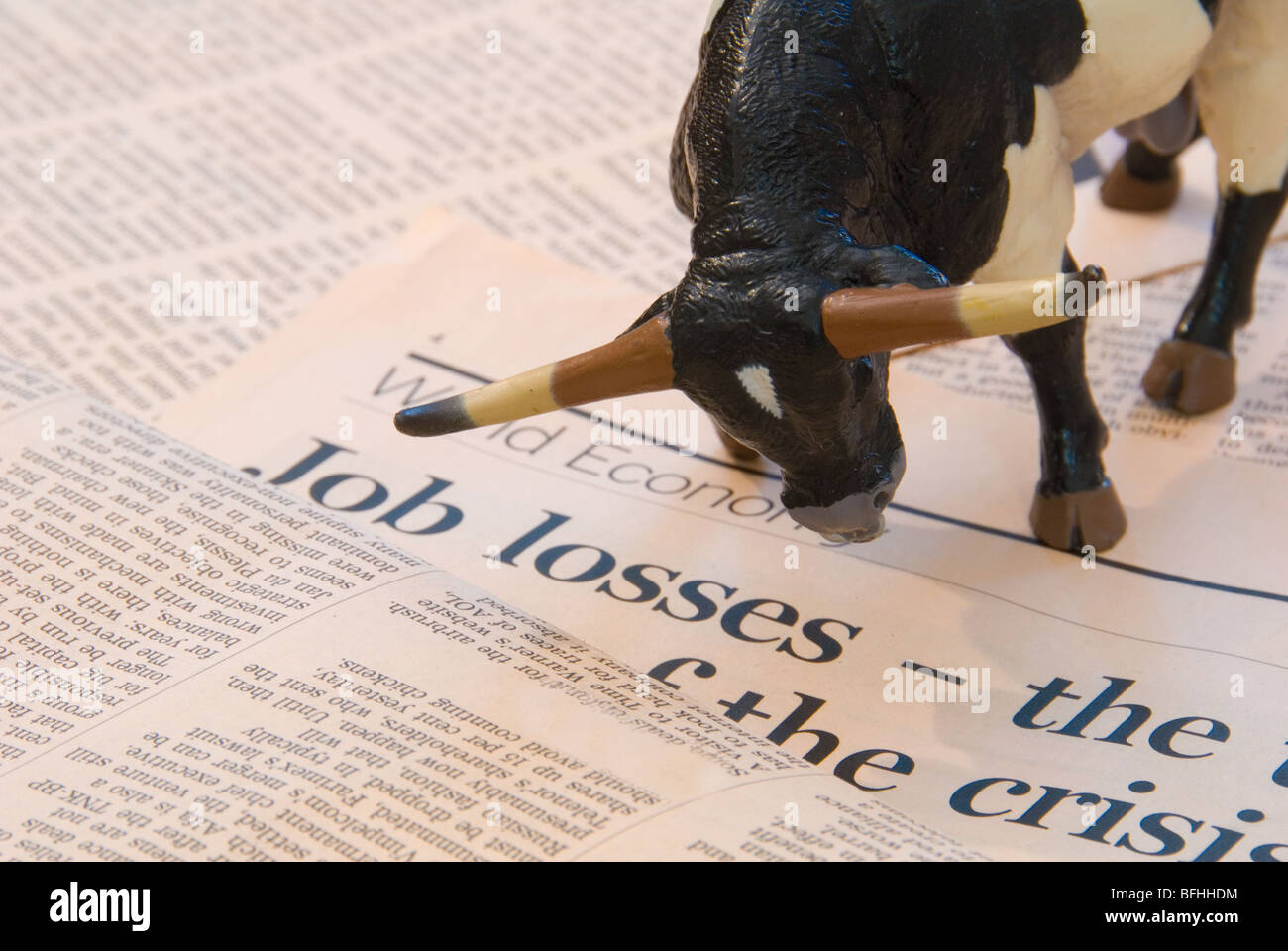 A Bull over the World Economy reports of Job Losses representing the Finance Markets Stock Photo