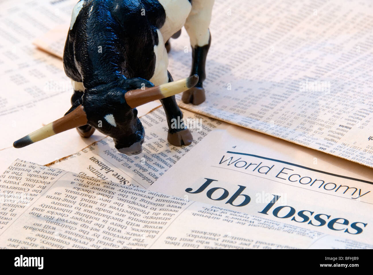 A Bull over the World Economy reports of Job Losses representing the Finance Markets - Stock Image