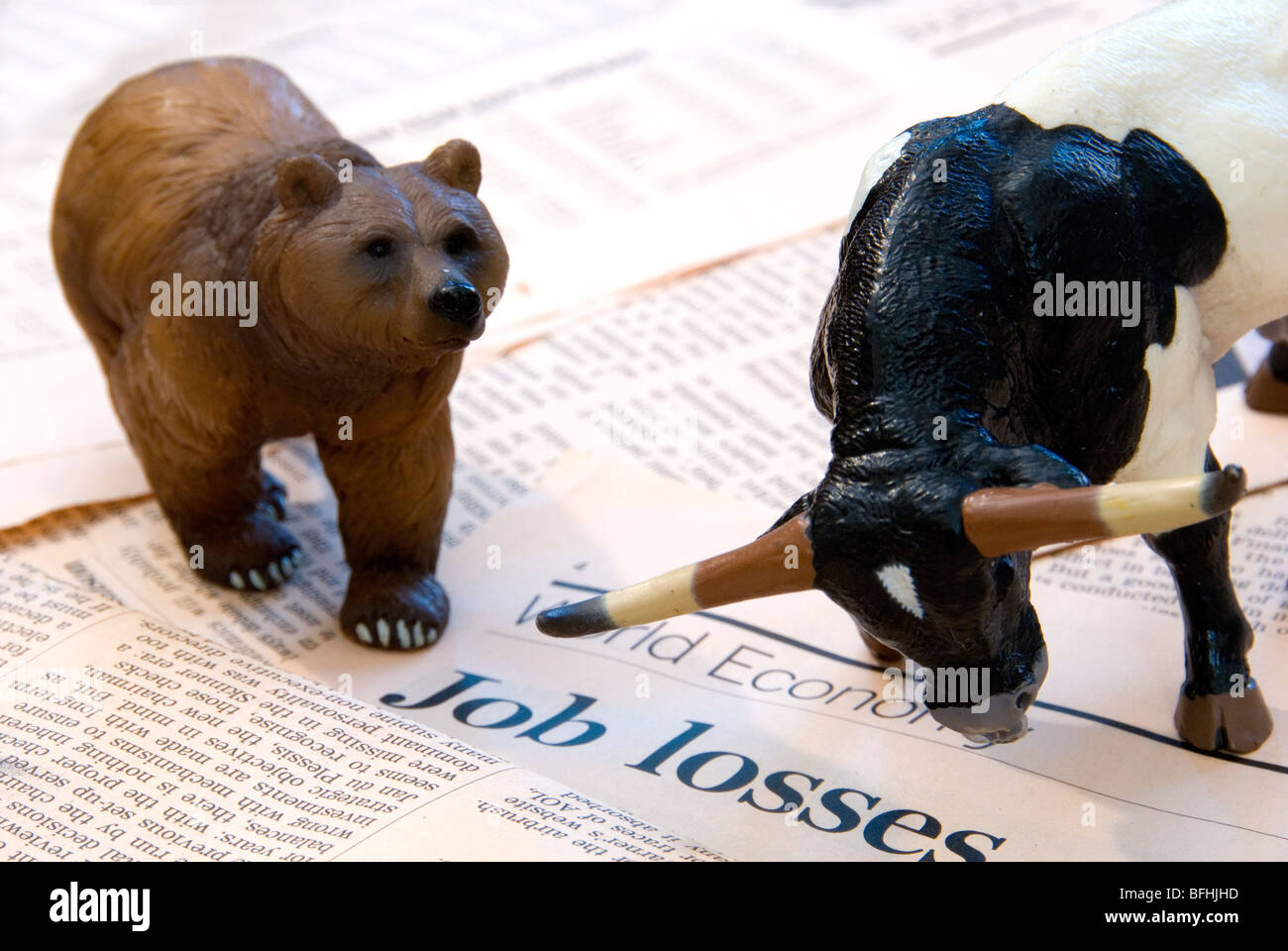 A Bull and Bear over the World Economy reports of Job Losses representing the Finance Markets - Stock Image