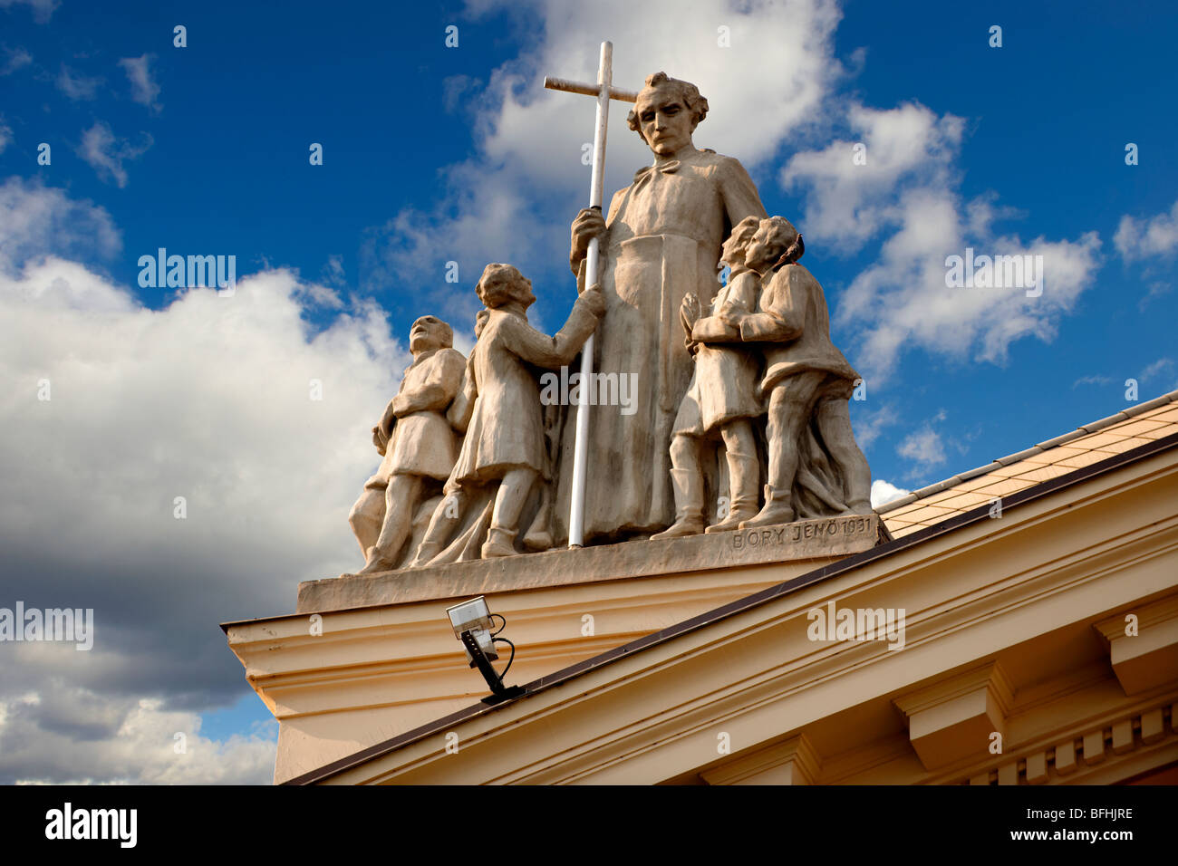 statue on a Neo Classic school- Kecskemet , Hungary - Stock Image