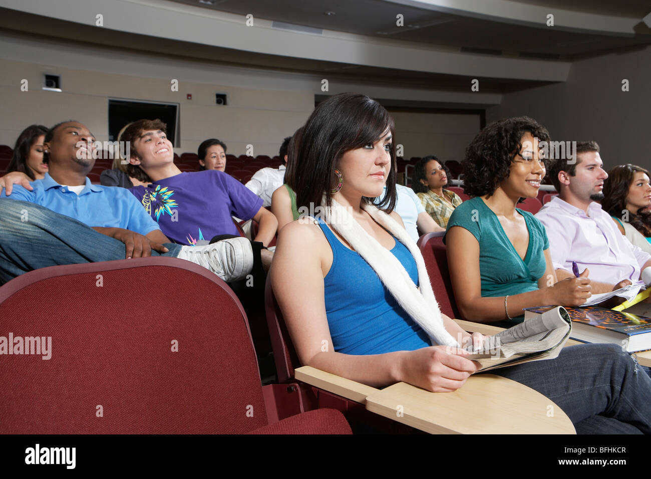 Students sitting in lecture theatre during lesson - Stock Image