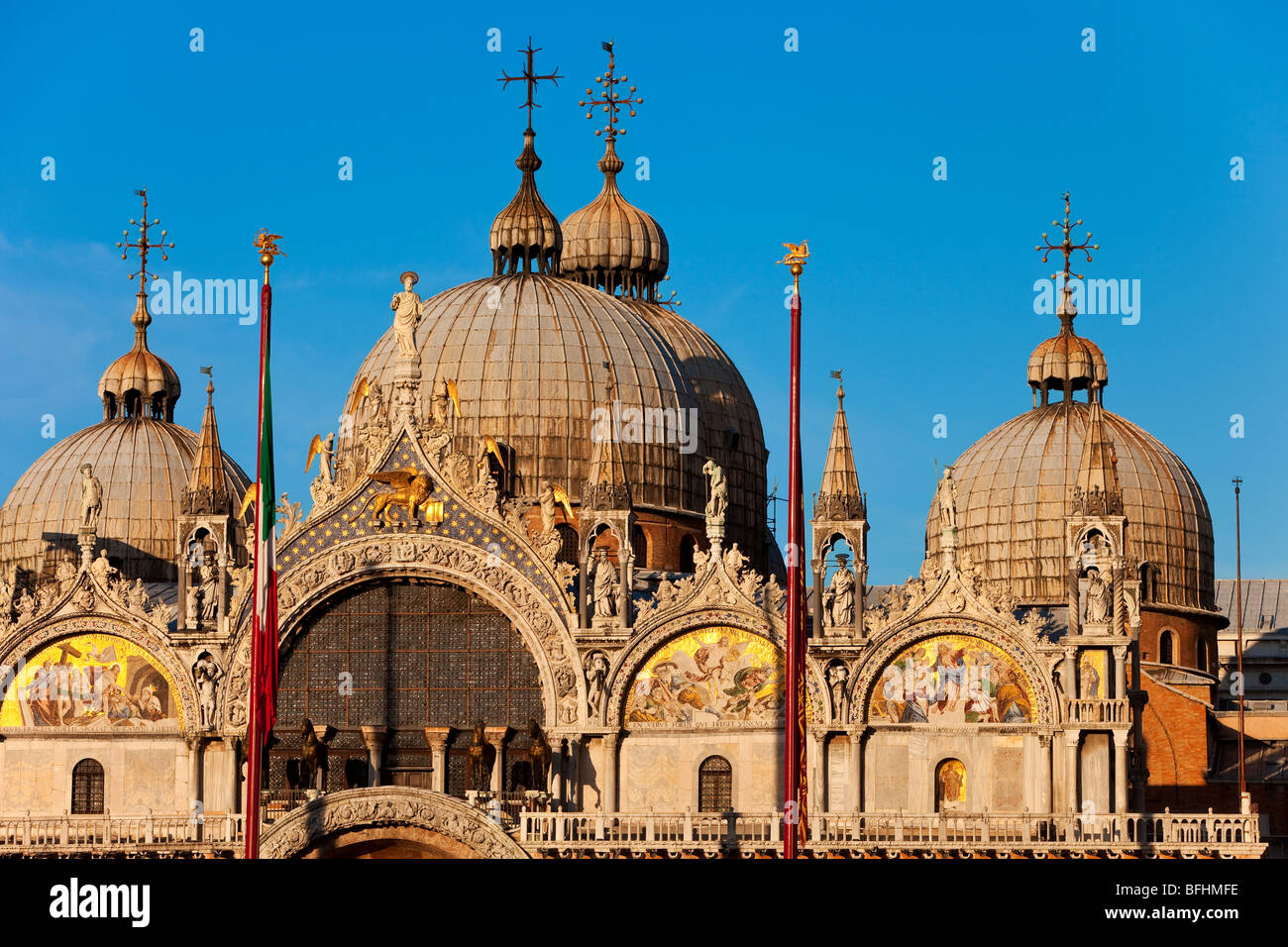 Warm glow of sunset on the detailed architecture of the Basilica San Marco in Venice, Veneto Italy Stock Photo