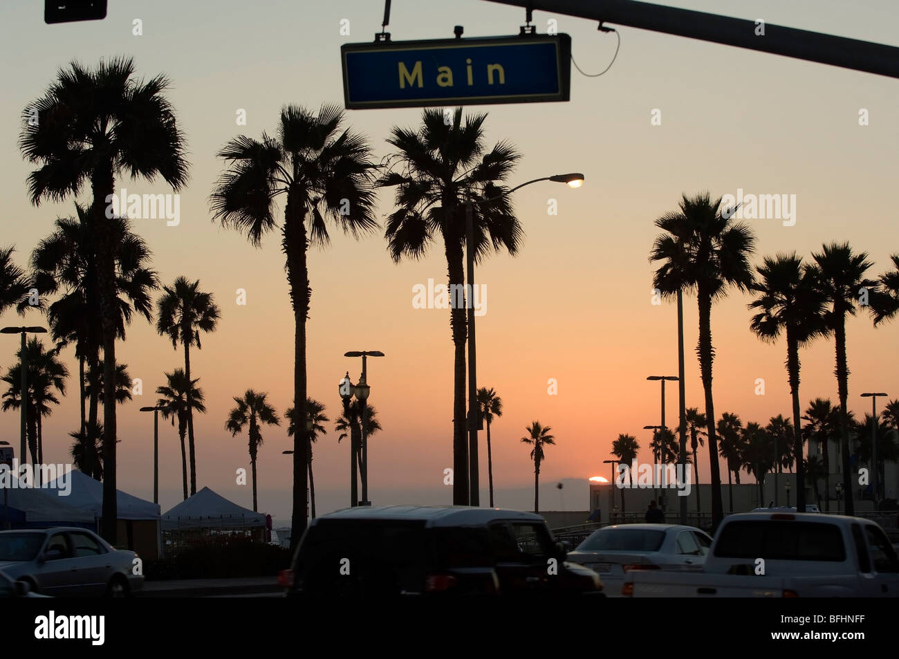 Main Street Huntington Beach At Sunset Showing Palm Trees In This Southern California Scene