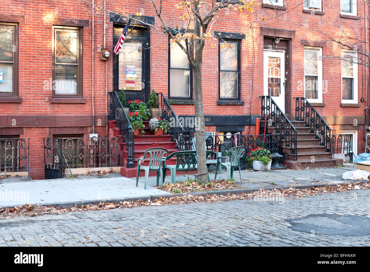 ground floor view charming old restored brick row houses on Coffey street in a gentrified area of Red Hook Brooklyn - Stock Image