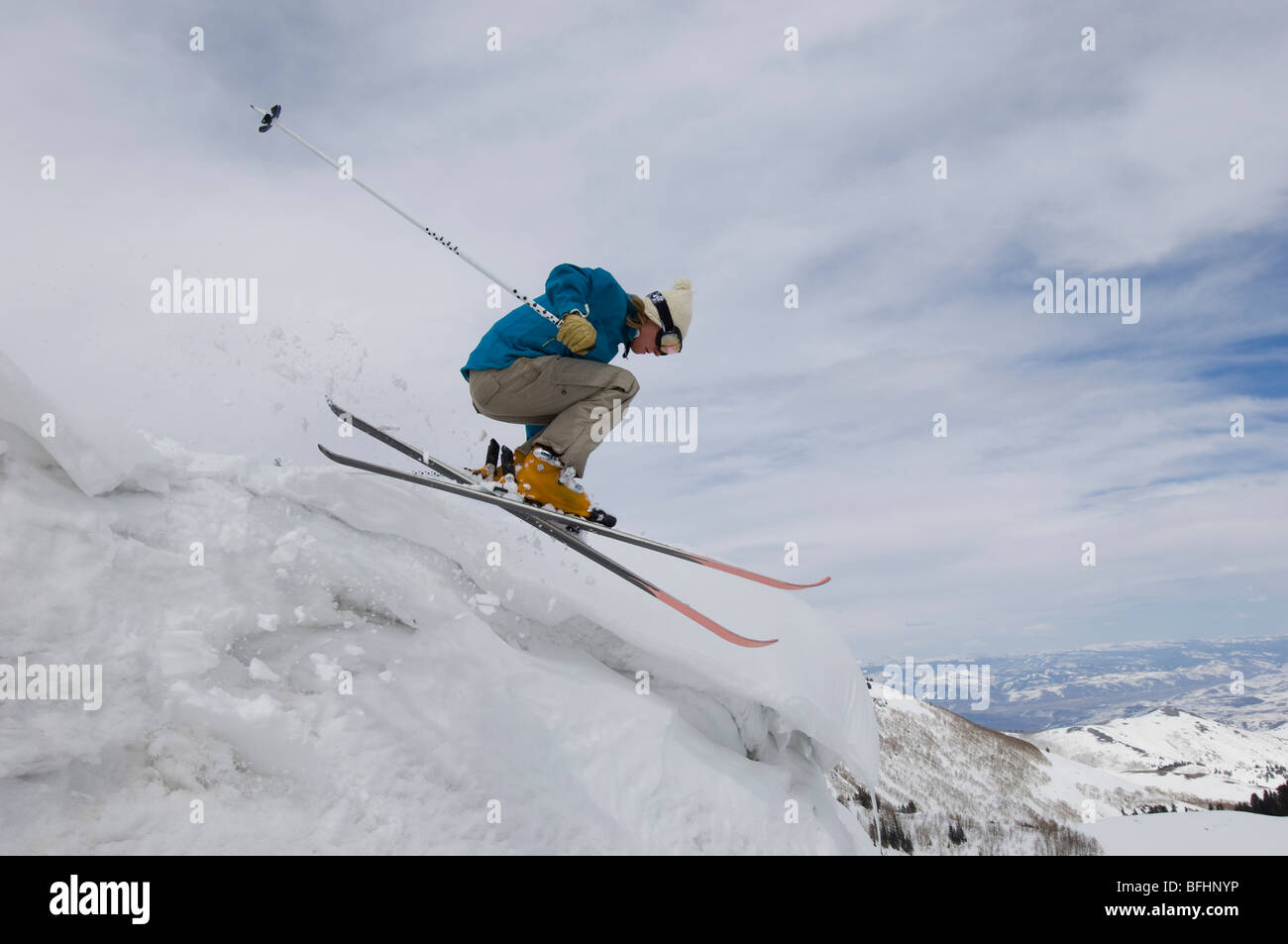 Skier Jumping Off Icy Overhang - Stock Image