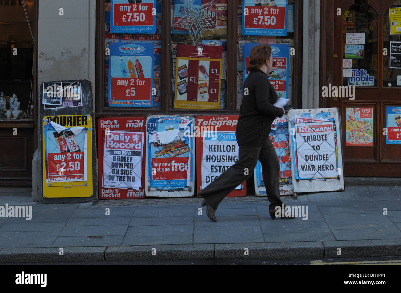 Newspaper headlines on advertising boards outside a newsagent. - Stock Image