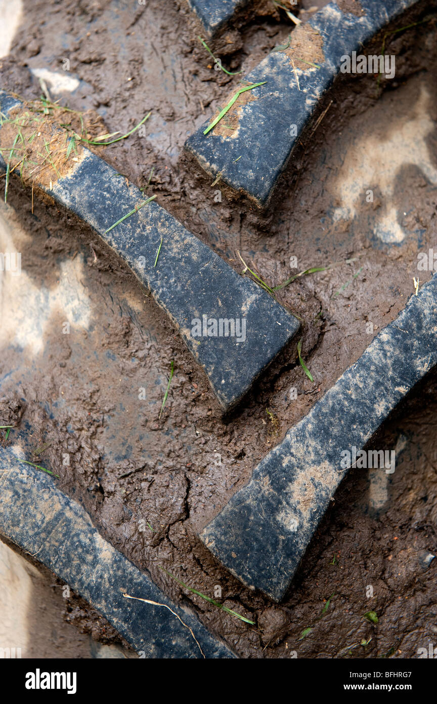 Close up of tractot tyre with mid on. - Stock Image