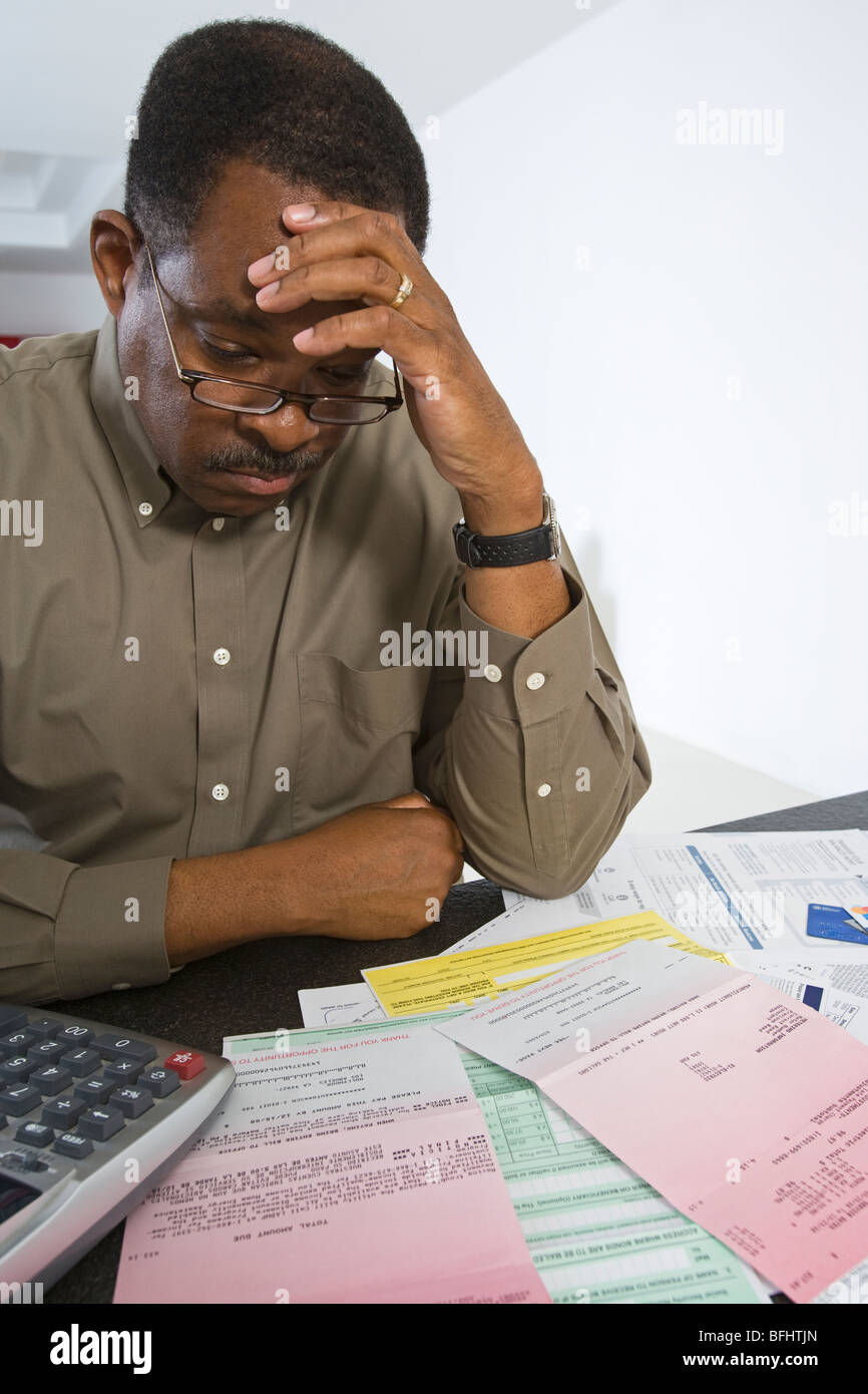 Senior Man Worrying About Home Finances - Stock Image