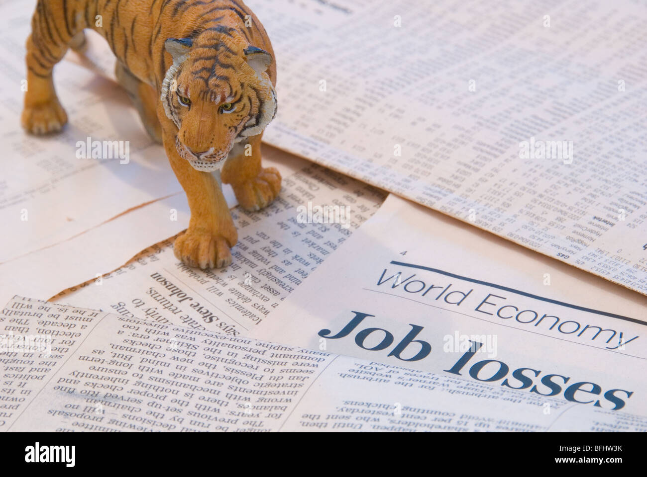 A tiger over the World Economy reports of Job Losses representing the Asia Markets - Stock Image
