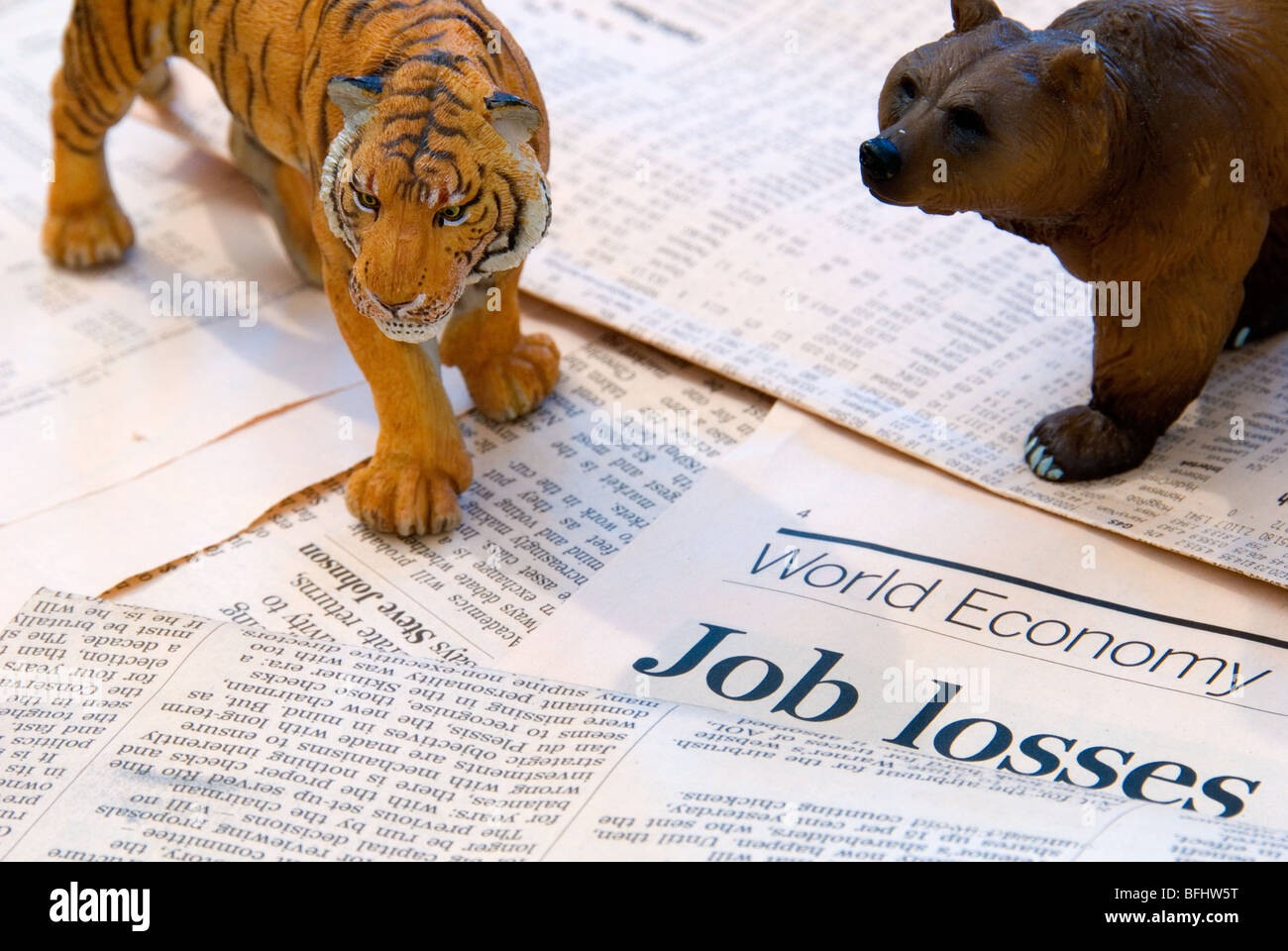 A tiger and Bear over the World Economy reports of Job Losses representing the Asia Markets - Stock Image