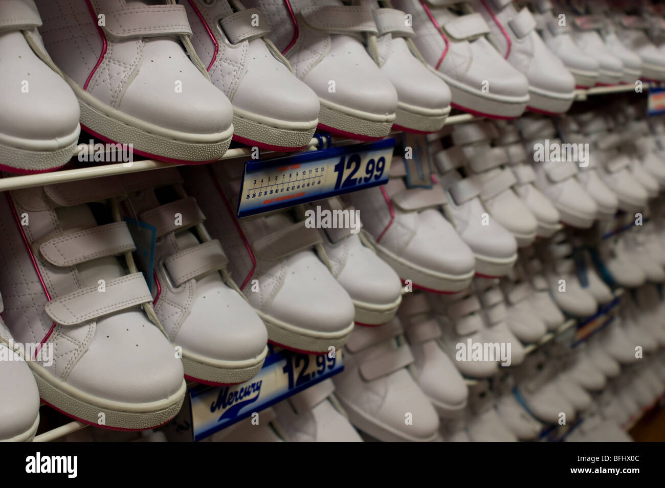 Rows of childrens trainers for sale in a North  London shoe shop - Stock Image