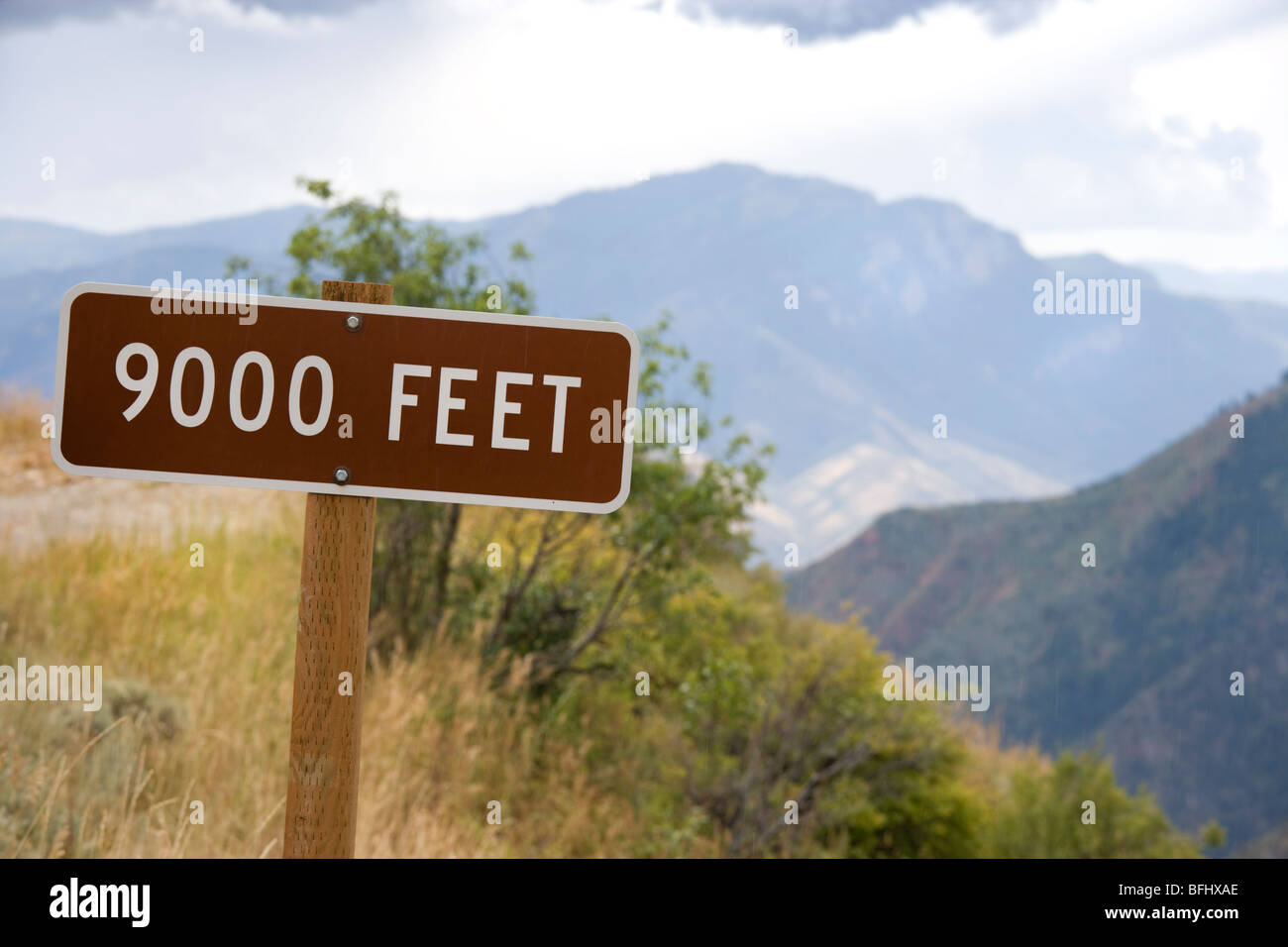 Sign altitude 9000 ft feet. Mt Nebo Utah in the distance seen from the Utah Lake Overlook on the Mount Nebo Loop - Stock Image