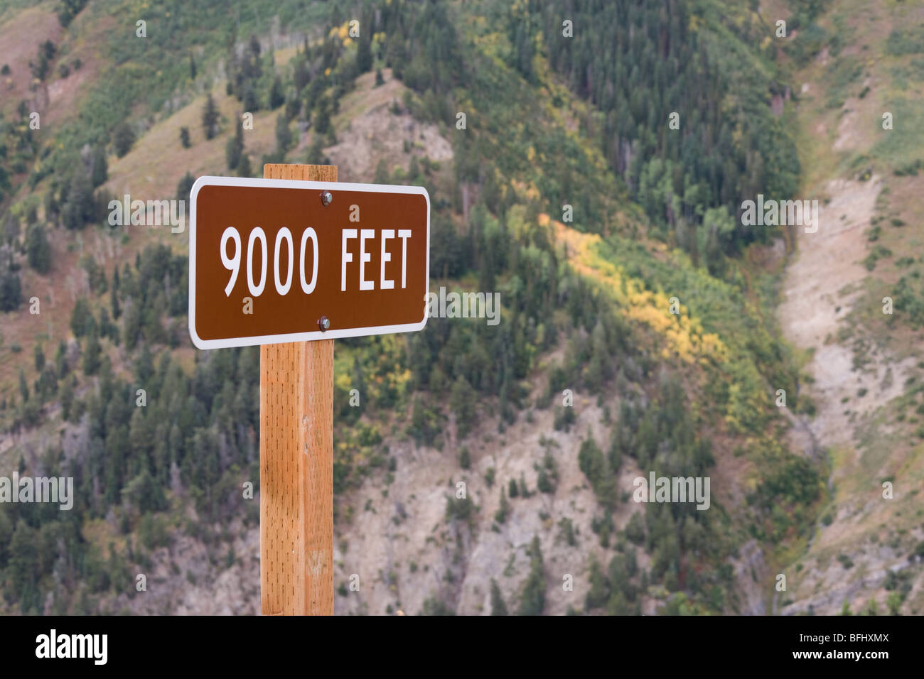 Sign high altitude 9000 ft feet. Looking down from the Mount Nebo Loop US Scenic Byway. The first signs of autumn. - Stock Image
