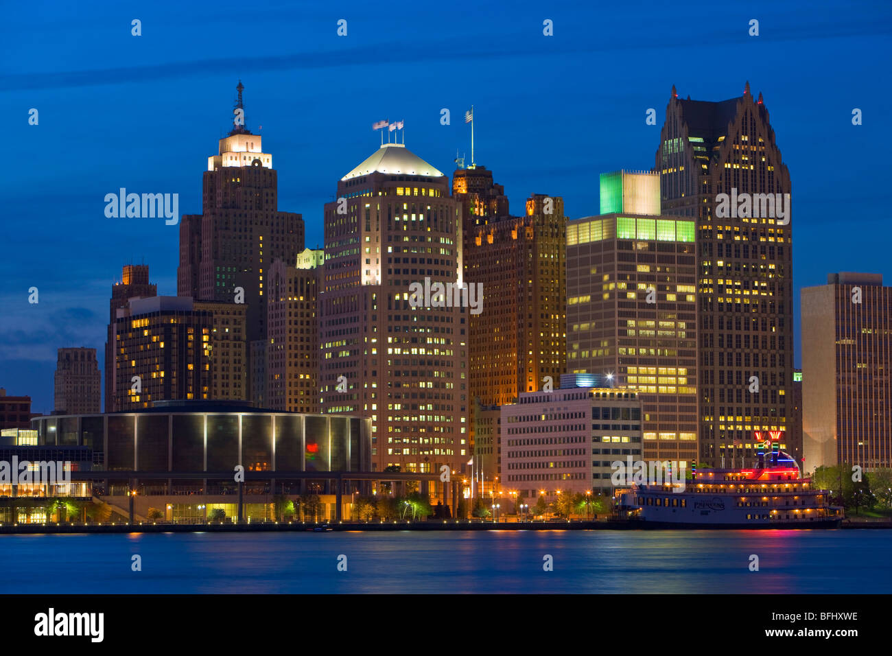 Skyline of the city of Detroit at dusk on the Detroit River in Michigan, USA seen from the city of Windsor, Ontario, - Stock Image