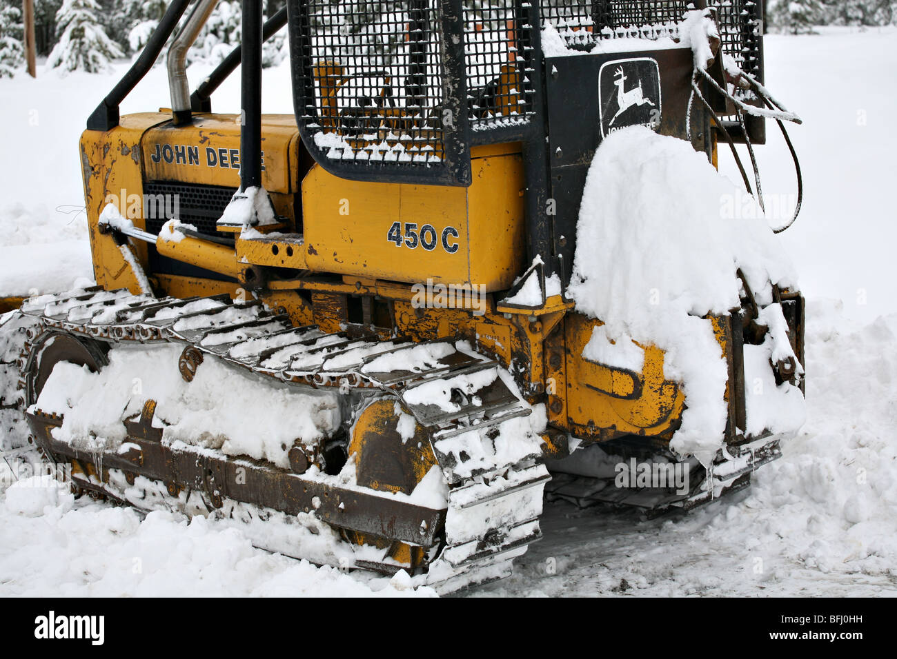 John Deere 450 C Bulldozer in the snow Stock Photo: 26825837