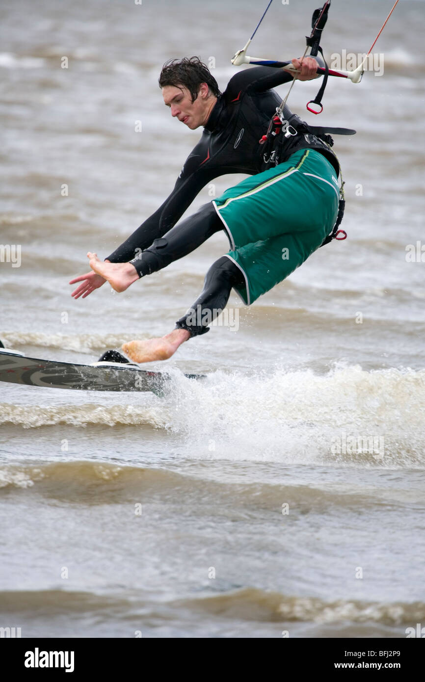 Kite surfer loosing his balance whilst landing on the water during the BKSA Kite surfing competition at Hunstanton - Stock Image