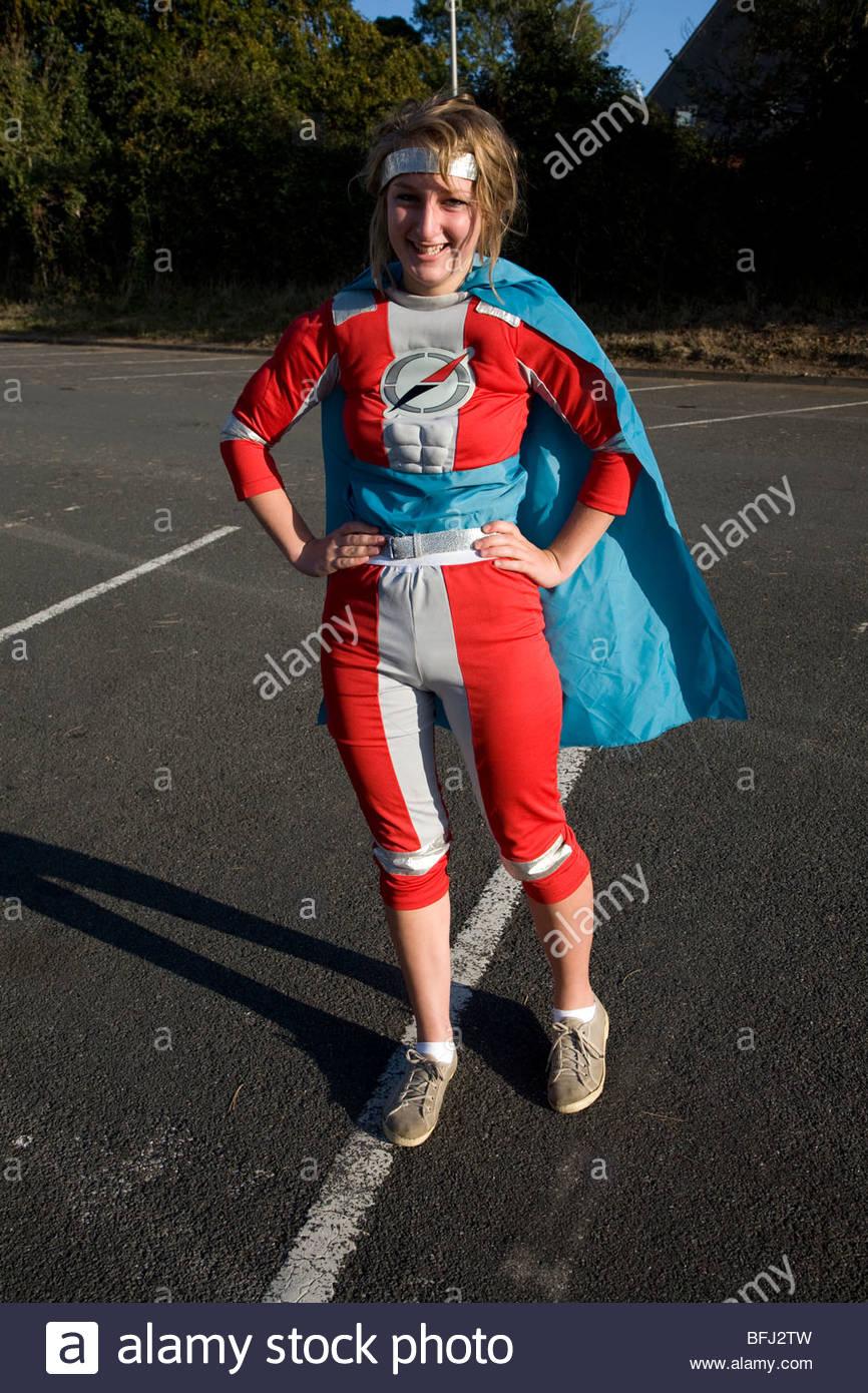 Teenage girl in super hero costume - Stock Image