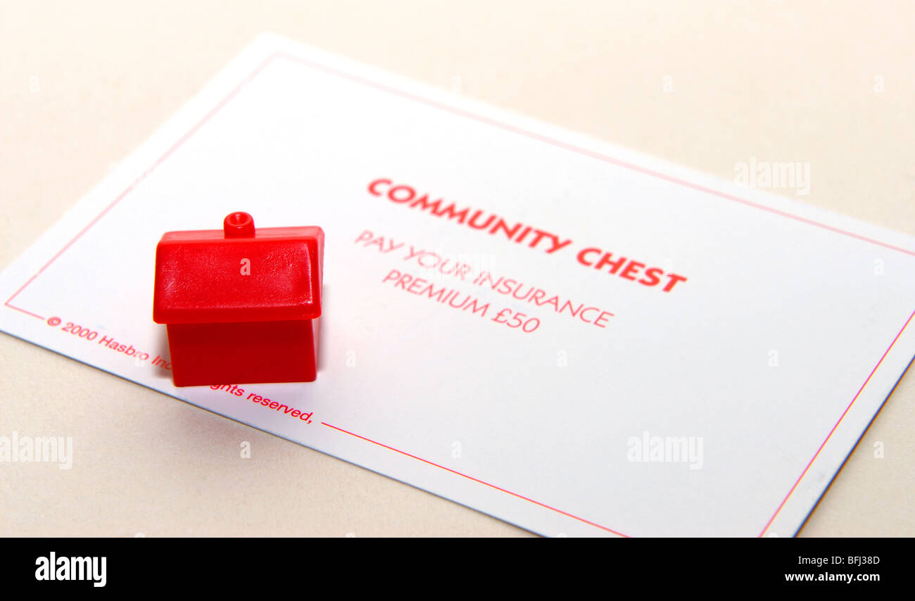 monopoly community chest card with house figure to illustrate request to pay house insurance premium - Stock Image