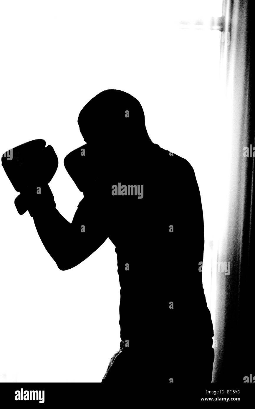 The silhouette of a boxer, Sweden. - Stock Image