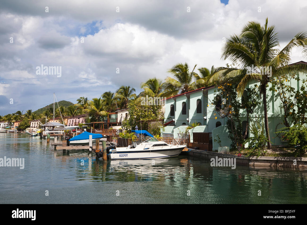 Harbourside houses at the marina in Jolly Harbour, Antigua - Stock Image