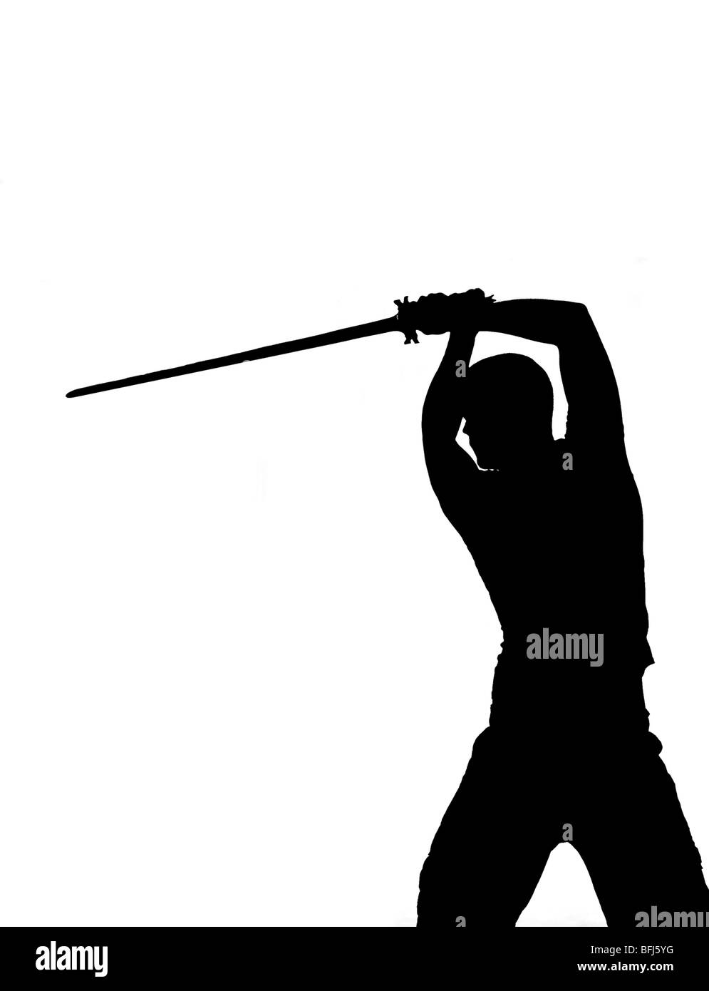 The silhouette of a man lifting a sword, Sweden. - Stock Image