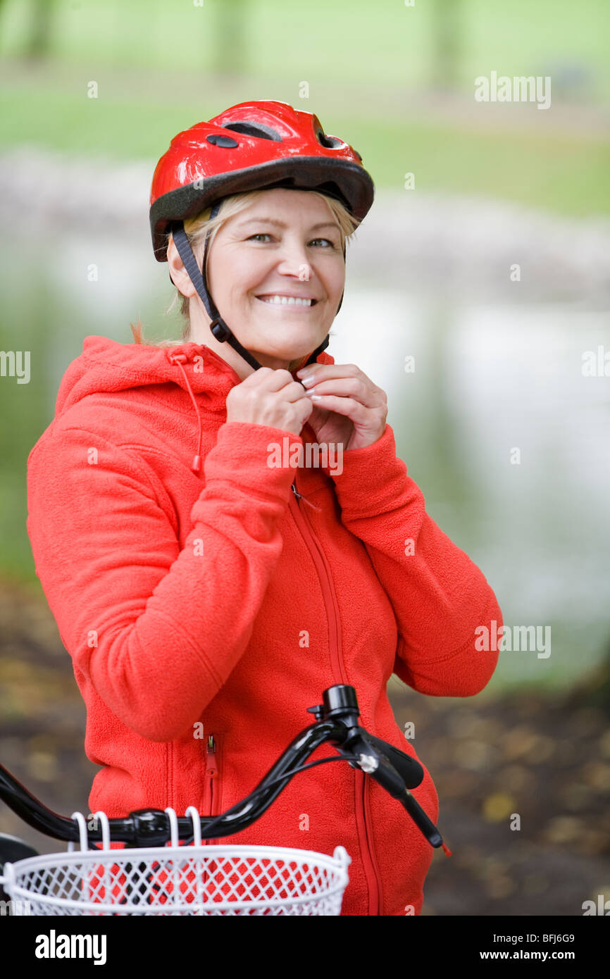 A woman on a bicycle, Sweden. - Stock Image