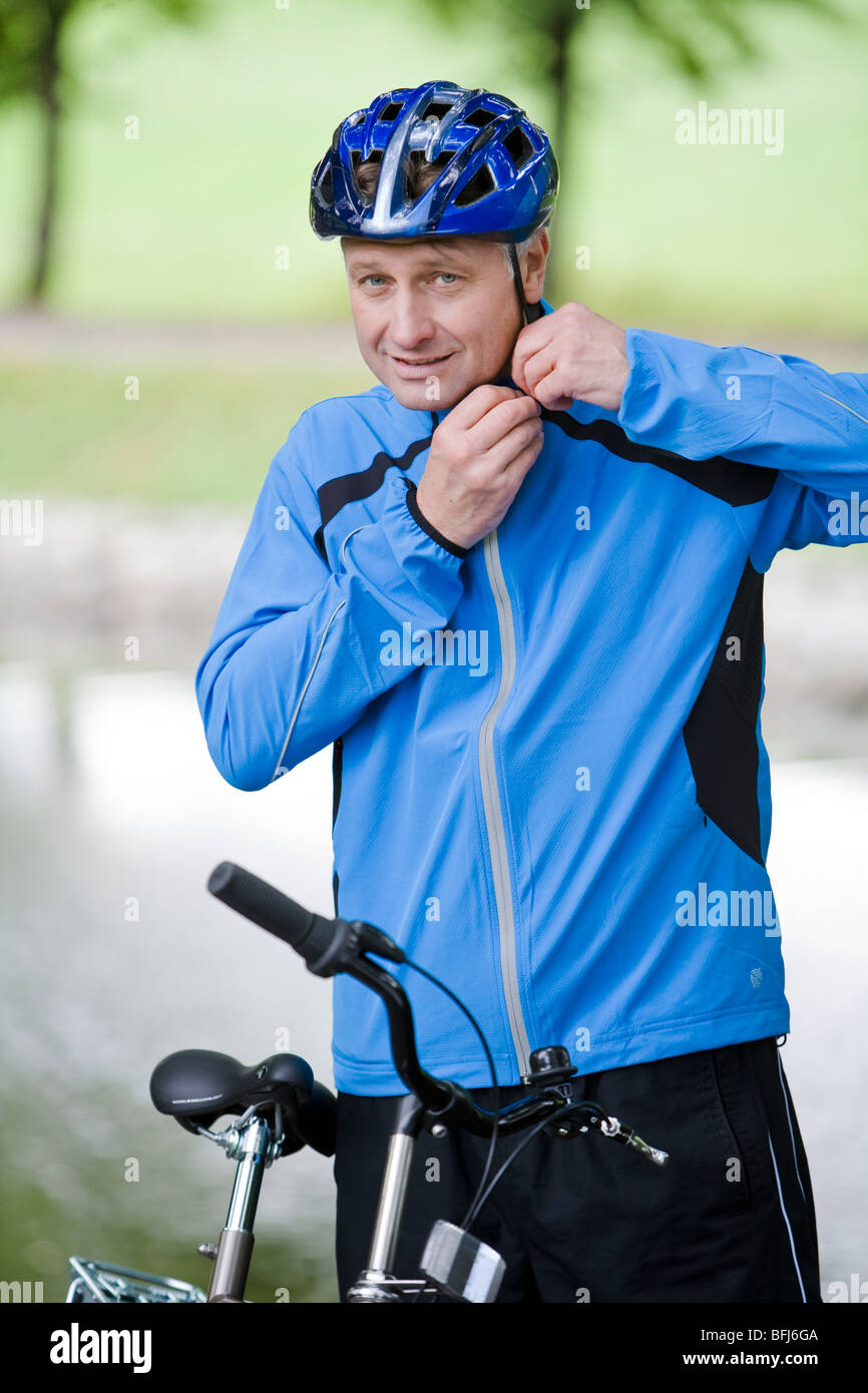 A man on a bicycle, Sweden. - Stock Image