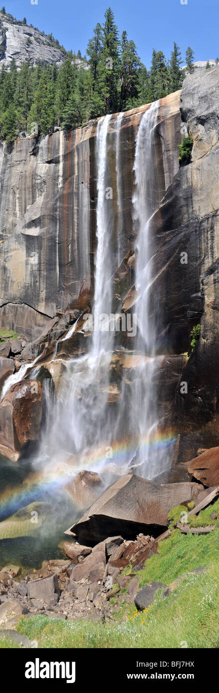 Vernal Falls in Yosemite Valley pictured in August with a fallbow or sunbow at the base of the falls - Stock Image